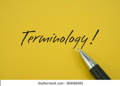 Terminology! note with pen on yellow background