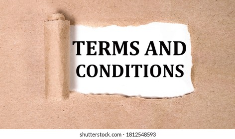 terms and conditions text on white backing on torn paper