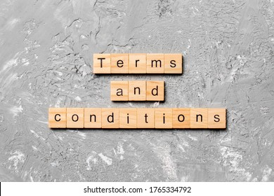 Terms and Conditions word written on wood block. Terms and Conditions text on table, concept.