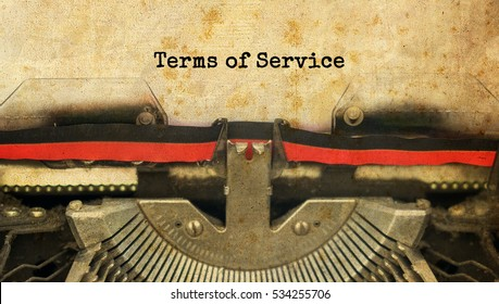 Terms Of Service typed words on a vintage typewriter with vintage background
