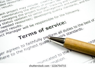 Terms of service with wooden pen