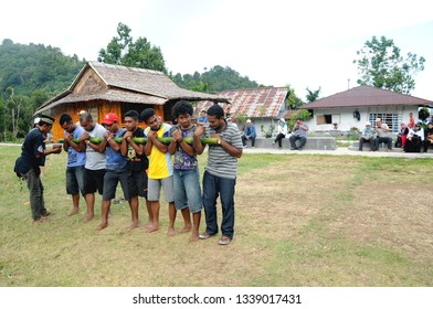 Ternate, North Moluccas/Indonesia - November 3, 2013: Bambu Gila dance; a mystical ritual performed in Maluku, where a group of strong men struggle to control a piece from moving around like crazy