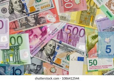 Ternopil, Ukraine - February  12, 2018:  American dollars, European euro, Swiss franc, Canadian dollar, australian dollar  bills