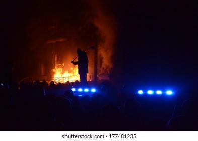 TERNOPIL, UKRAINE- FEBRUARY 18: Sturm of police department by activists Ukrainian revolution on February 18, 2014 in Ternopil, Ukraine. Protestants burned police department, overturned police cars.