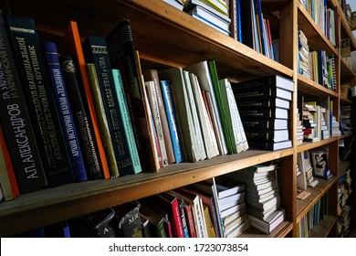 Ternopil, Ukraine, February 2019 Bookshelves in the public library, shelves of colorful books of different genres, educational and fiction. Concept of reading books.