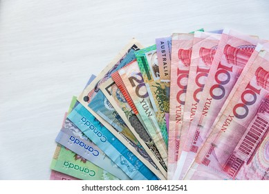 Ternopil, Ukraine - March 10, 2018:  Collection of four countries banknote on wooden table