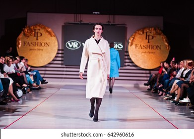 Ternopil, Ukraine - May 12, 2017: Fashion models wearing at coat clothes designed by VR Studio from the autumn/winter collection at the Podolyany fashion show.