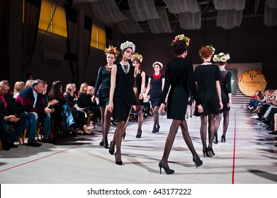 Ternopil, Ukraine - May 12, 2017: Fashion models wearing traditional clothes with wreath on had designed by Etno Svit from the spring/summer collection at the Podolyany fashion show.