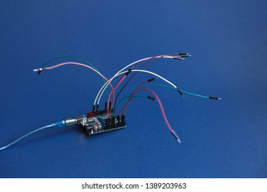TERNOPIL, UKRAINE - May 5, 2019: Arduino Uno board micro controller for the development of simple automation systems and robotics, microcircuit, wires for building digital devices, interactive objects