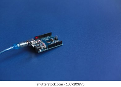 TERNOPIL, UKRAINE - May 5, 2019: Arduino Uno boards for programming education development platform connected to PC with a USB cable. Micro controller. Technology. Electronic computing machine. Concept