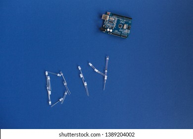 TERNOPIL, UKRAINE - May 5, 2019: DIY word from diode and arduino uno on a blue background. arduino board. DIY words for Do It Yourself concept. place for text. Technology. Electronic computing machine
