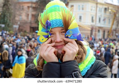 Ternopil, UKRAINE- November 18: young girl in the central square of Ternopil on rally during Euromaidan.  Meeting in support of Ukraine's European course on November 18, 2013 in Ternopil, Ukraine.