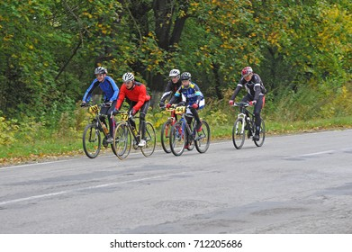 TERNOPIL, UKRAINE - SEPTEMBER 29, 2013: People ride bicycles on an asphalted road