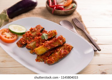terong balado, deep-fried eggplant served with tomato and chili paste, or sambal. indonesian food