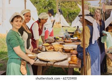 "TERRA DEL SOLE, ITALY - OCTOBER 3: unidentified girls prepare launch in medieval festival ""Tempus belli"" on October 3, 2010 in Terra del sole, Italy. camp for historical reenactors of age 1350-1450"