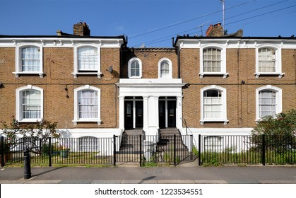 A terrace of 19th century Victorian period grade two listed housing at Hammersmith, west London, UK.