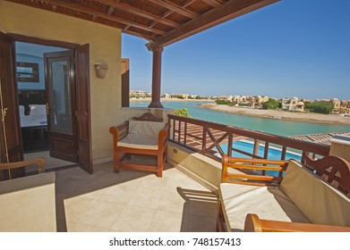 Terrace balcony furniture from bedroom of a luxury villa in tropical resort with chairs tables and sea view