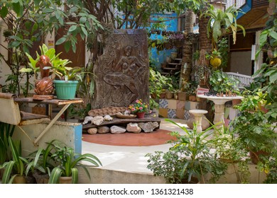 Terrace design in asian village, Philippines. Wooden decoration with plants and flower pots in tropical patio. Beautiful backyard. Gardering concept. Philippines traditional courtyard. Travel concept.