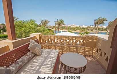 Terrace furniture of a luxury villa in tropical resort with chairs and sea view over lagoon