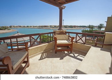 Terrace furniture of a luxury villa in tropical resort with chairs table and sea view over lagoon