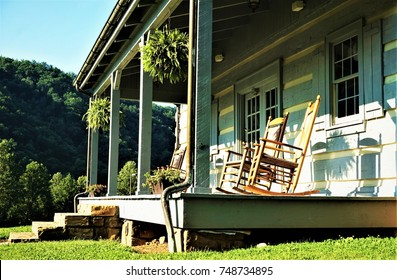 Terrace of the house with 4 rocking chairs on the background of the mountain and garden, Summer in TENN USA.