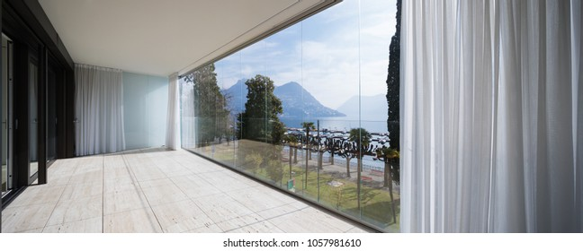 Terrace with large windows overlooking the nature and the lake.