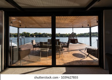 Terrace of log cabin on river