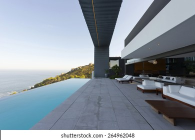 Terrace of luxury house with infinity swimming pool overlooking the sea.