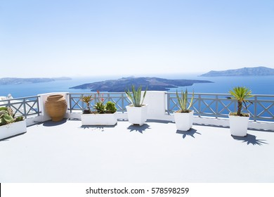 Terrace with the Mediterranean flowers on Santorini island