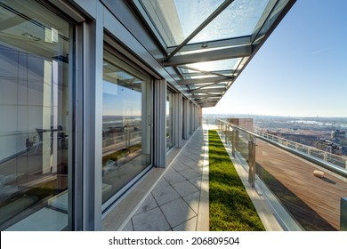 Terrace with metal and glass construction in modern building