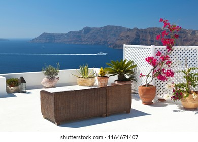 A terrace in Oia with view to the other islands of the crater rim in Santorini.