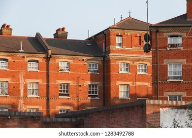 Terrace of red brick built houses with sash windows around Cambridge Heath in east London