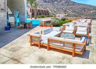 Terrace sea view with lounge sofa and armchair in a summer resort, Crete, Greece.