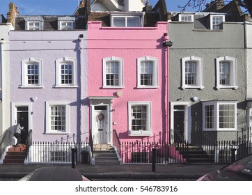 A terrace of small eighteenth century English Georgian period town houses in Chelsea, London, UK.
