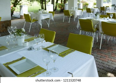 terrace summer cafe with tables and chairs for people, an empty institution for recreation, nobody