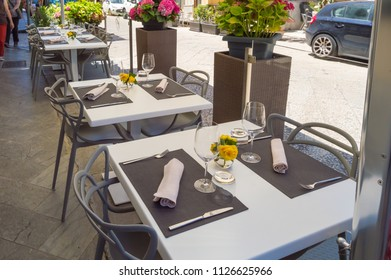 Terrace table of a Monreale restaurant with the old town in the background in northern Sicily italy