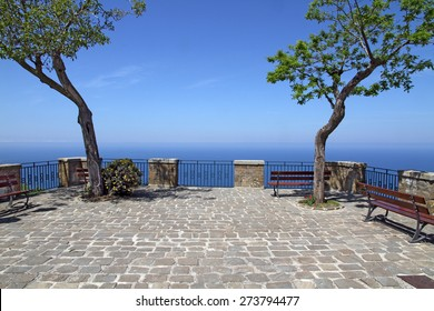 Terrace with trees and sea view. Cobble-paved terrace in Castellabate, Italy (Cilento)
