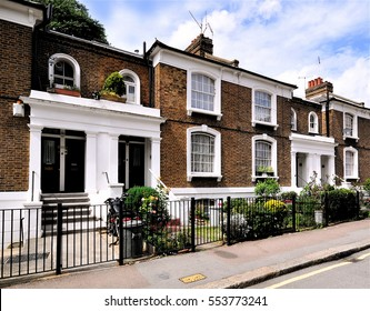A terrace of typical small 19th century Victorian period town houses at Angel Walk, Hammersmith, west London, UK.