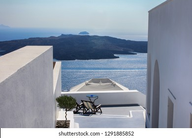 Terrace of the white house overlooking the sea, travel and holidays on the island of Santorini