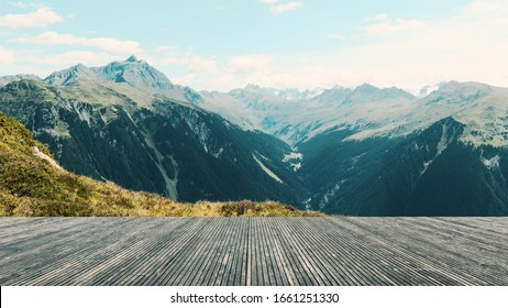 Terrace with a wonderful view. Panorama with imposing mountains and a blue sky. Live in the mountains. Austria