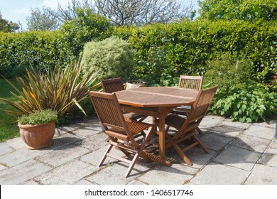 Terrace and wooden garden furniture in a garden during spring