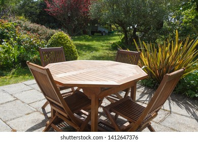 Terrace and wooden garden furniture during spring