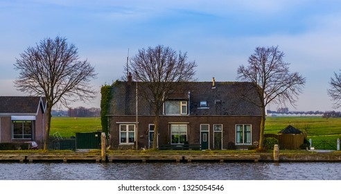Terraced house with water at the country side, city scenery of Alphen aan den rijn, The Netherlands