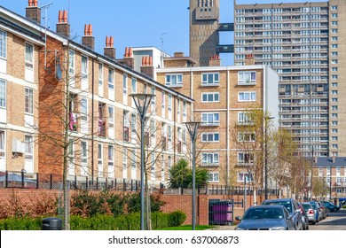 Terraced houses in contrast to council housing blocks in the background