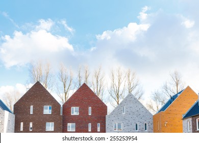 Terraced houses with minimalist design and different colors with classic gabled roof