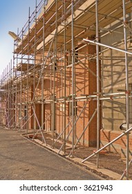 terraced houses with scaffold erected