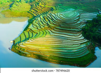 Terraced rice field in morning in water season, the time before starting grow rice in Y Ty, Lao Cai province, Vietnam