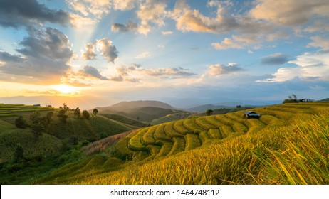 Terraced Rice Field at sunset time with sun rays in Chiangmai, Thailand