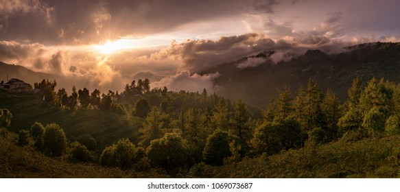 Terraces, rice fields and villages in Himalayas, Nepal. Sunset and clouds, Trekking in Annapurna and Nilgiri region