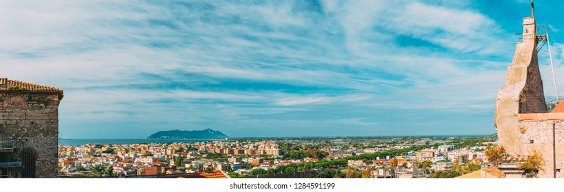 Terracina, Italy. Facade Of Church Of Purgatory And View Of Terracina With Circeo Promontory And Tyrrhenian Sea In Background.